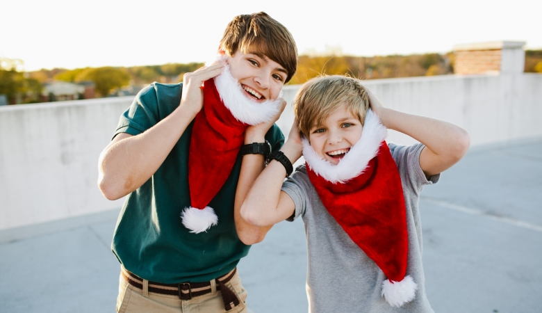 two boys using Santa hats as beards