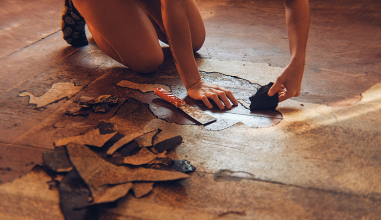 Woman working on the floor in her house