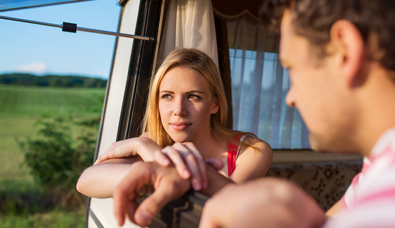 Woman looking out an RV window