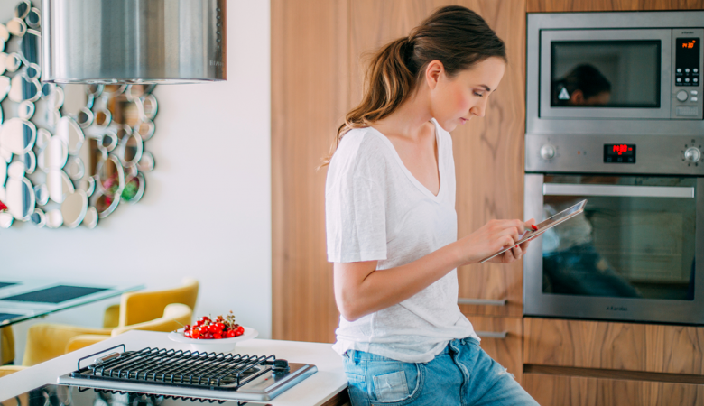 Woman on tablet in her kitchen