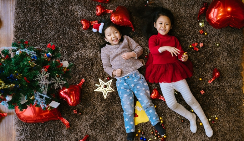 Two children on Christmas carpet