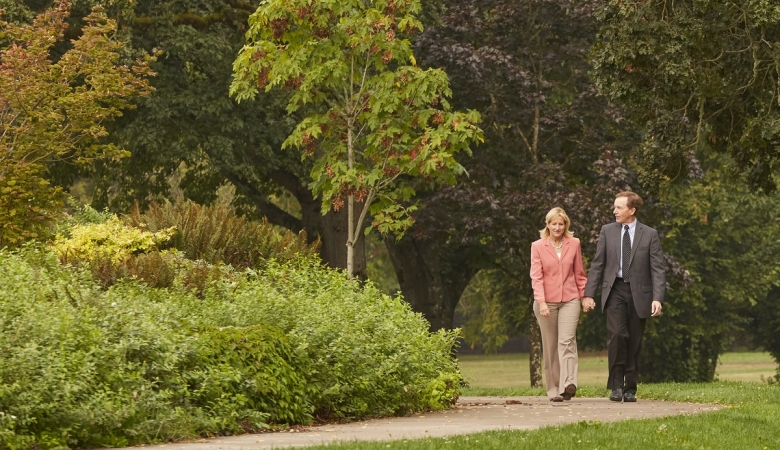 Couple walking down a path in a park