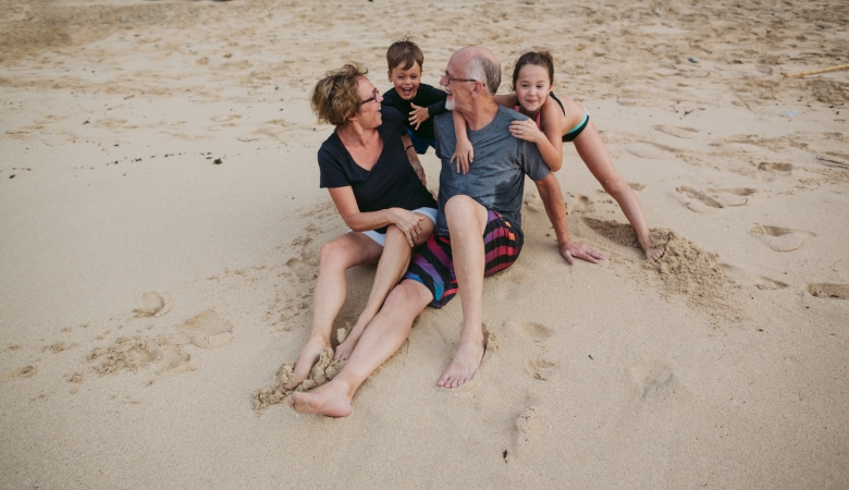 Family playing on a beach