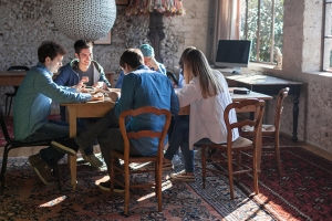 Students studying around a table in sunlight