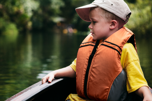 Young boy in a boat on a lake