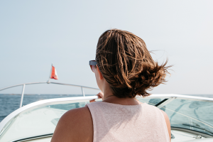 woman standing in a speed boat
