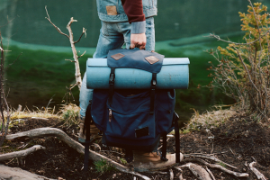 Backpack and camping mat by a lake