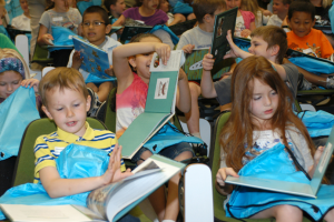 Kids reading books at Gift of Literacy