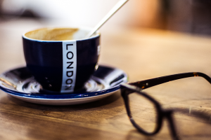 Tea cup that says London with reading glasses