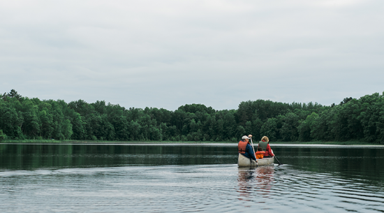 Two people in a canoe on a lake