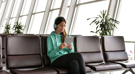 Woman in blue sitting in airport